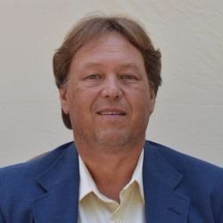 Theodore DeVos @ National Land Realty