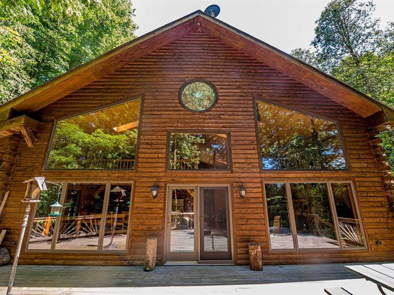 Captivating Log Home On River : Ludington : Mason County : Michigan