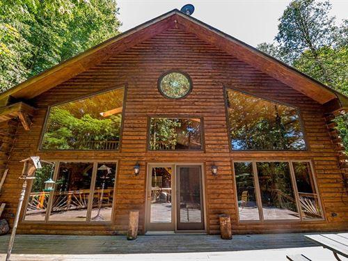 Captivating Log Home On River : Ludington : Mason County : Michigan