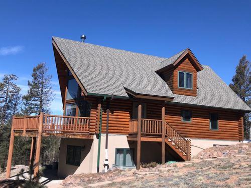 Log Cabin Woodland Park Co, Backs : Woodland Park : Teller County : Colorado